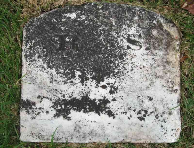 Six Inches Under - This grave was found in the cemetery we visited. It had fallen over. When we returned it to an upright position, we discovered it read